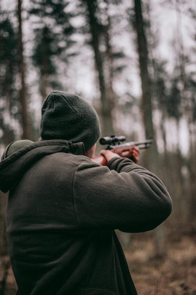 Vortex Optics Ranger 1500 man in woods using rifle